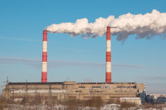 The smoke from the chimney of the industrial plant. Industrial, ecology and environmental protection. The smoke from the chimney of the industrial plant Stock Photo