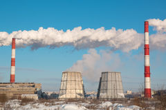 The smoke from the chimney of the industrial plant. Industrial, ecology and environmental protection. The smoke from the chimney of the industrial plant Royalty Free Stock Images