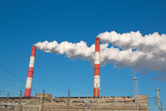 The smoke from the chimney of the industrial plant. Industrial, ecology and environmental protection. The smoke from the chimney of the industrial plant Royalty Free Stock Photos