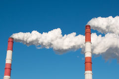 The smoke from the chimney of the industrial plant. Industrial, ecology and environmental protection. The smoke from the chimney of the industrial plant Stock Photography