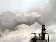 Smoke - Chimney Pollution. Smoke from chimney polluting the air Stock Photo