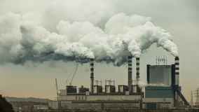 Smoke from chimney of power plant or station. Industry Royalty Free Stock Photography