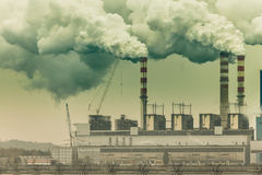 Smoke from chimney of power plant or station. Industry Royalty Free Stock Images