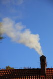 Smoke from a chimney sky blue royalty free stock images
