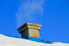 Smoke from a chimney on winter Royalty Free Stock Photography
