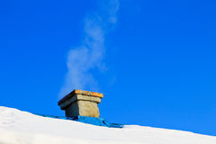Smoke from a chimney on winter Royalty Free Stock Images