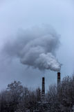 The smoke from the chimneys of the CHP Stock Image