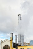 Smoke from chimneys of district heating station Stock Images