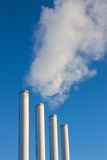 Smoke chimneys emissions. Factory smoke chimneys emissions polluting the air royalty free stock photo