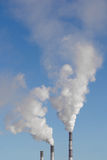 The smoke from the chimneys. The environmental pollution. Smoke rising from the chimneys Stock Photography