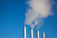 Smoke chimneys. Factory smoke chimneys contaminate the air causing pollution stock photography