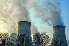 The smoke from the chimneys of a power plant Stock Photo