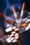 Smoke and cigarettes. In ash-tray on black background Stock Images