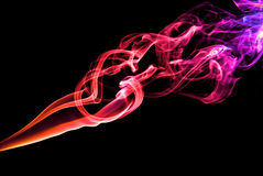 Smoke cloud. Energy movement. Smoke cloud on a black background with illumination Stock Photos