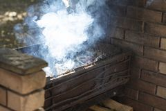 Smoke comes from the brazier. Trimmed with stone royalty free stock images