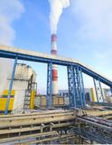 Smoke comes out of the pipe at the heat and power station. Panorama. Russia. Morning. Winter royalty free stock photography