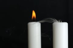 Burning and Blown Out Candle with Smoke royalty free stock photo