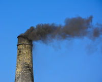 Smoke coming from chimney of a brick kiln. Somewhere near Shadia Mianwali – Punjab, Pakistan Royalty Free Stock Photo
