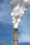 Smoke coming out a chimney Stock Photography