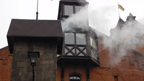 Smoke coming out of a chimney in a brick. Smoke coming out of a chimney in a the brick stock video footage