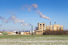 Smoke coming out of the factory chimneys Stock Image