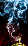 White perfumed oud Smoke coming out of golden pot  Stock Photography
