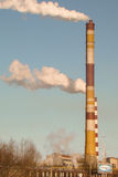 Smoke coming. Out of high tube hydro-electric station Stock Photography