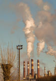 Smoke. Coming out of the many factory chimneys Stock Images