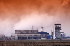 Smoke coming out of old factory chimney Royalty Free Stock Photography