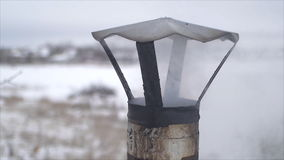 The smoke coming from the rusty chimney in the winter. stock video footage