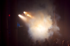 Smoke, concert and crowd of people. In hall stock images