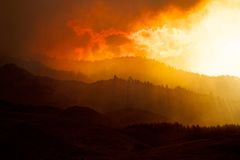 Smoke Covered Hills and Forest Fire royalty free stock photo