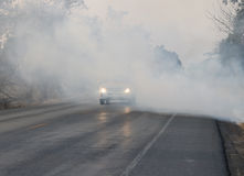 Smoke covering the road Stock Photo