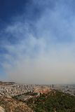 Smoke covers the city of Athens Greece Royalty Free Stock Image