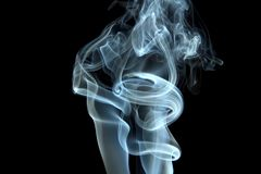 Smoke curls. On black background Stock Photography