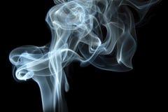 Smoke curls on black. Smoke swirls on black background stock photo