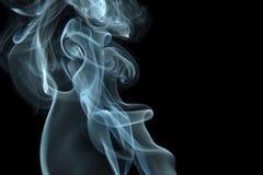 Smoke curls on black. Smoke swirls on black background stock photos