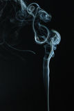 Smoke dance. Th photo show the abstract - smoke on the  black Stock Images