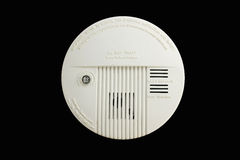 Smoke detector. Compact white generic ceiling smoke detector royalty free stock photo