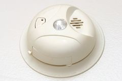 Smoke detector. Isolated smoke detector on a white wall Royalty Free Stock Photo