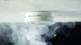 Smoke detector. Alarm, triggered by heavy smoke stock video footage