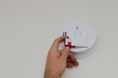 Smoke detector battery replacement Stock Photo