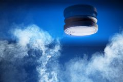 Smoke detector. On a blue background