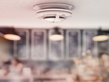 Smoke detector on ceiling royalty free stock photography