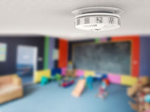 Smoke detector on ceiling Stock Photography