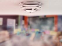 Smoke detector on ceiling Stock Photos