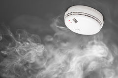 Smoke detector of fire alarm. In action royalty free stock images