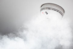 Smoke detector of fire alarm in action royalty free stock images