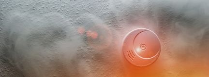Smoke detector on a roof detects smoke and give alarm stock photography