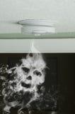 Smoke detector and smoke skull fire protection Royalty Free Stock Photos